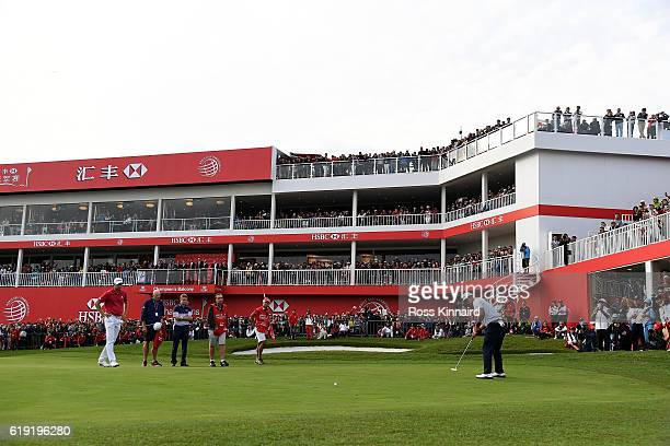 Hideki Matsuyama of Japan holes a putt for victory on the 18th green during day four of the WGC HSBC Champions at Sheshan International Golf Club on...