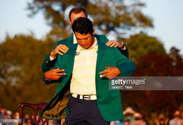 Hideki Matsuyama of Japan is awarded the Green Jacket by 2020 Masters champion Dustin Johnson of the United States during the Green Jacket Ceremony...