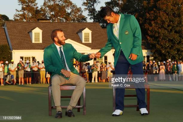 Hideki Matsuyama of Japan laughs with 2020 Masters champion Dustin Johnson of the United States during the Green Jacket Ceremony after Matsuyama won...
