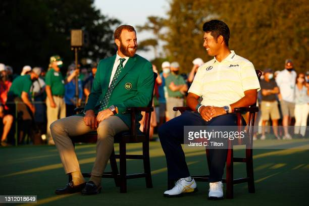 Hideki Matsuyama of Japan laughs with Dustin Johnson of the United States during the Green Jacket Ceremony after Matsuyama won the Masters at Augusta...