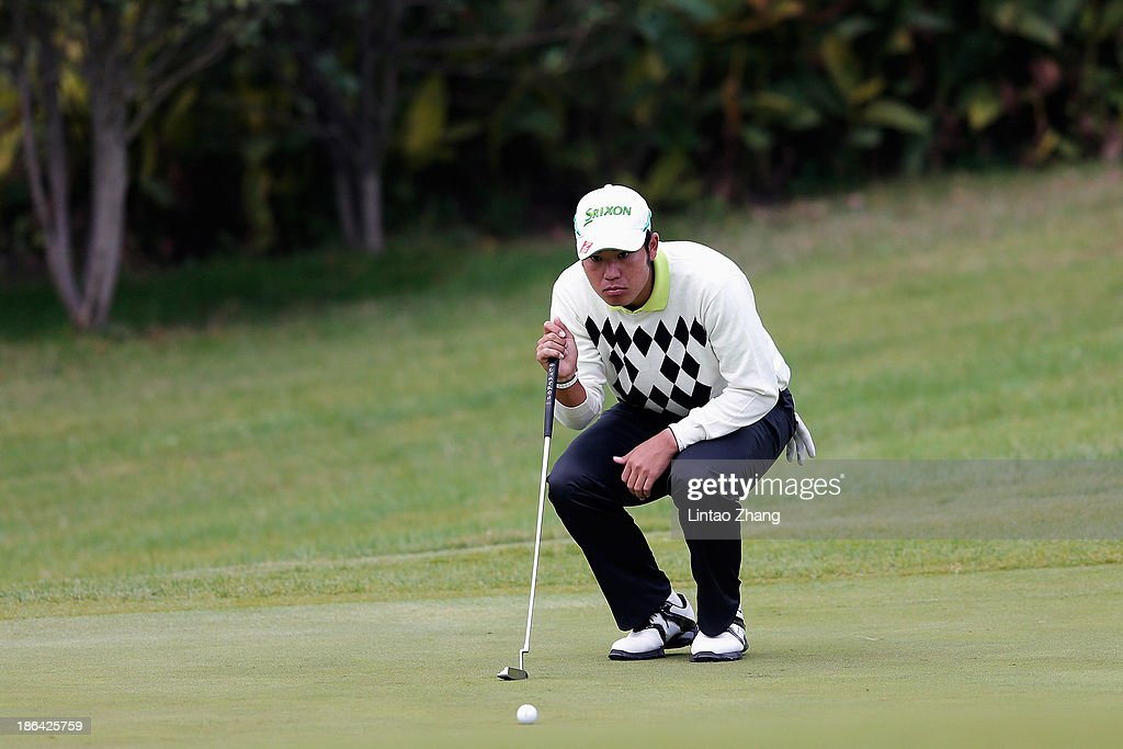 Hideki Matsuyama of Japan lines up a putt during the first round of the WGC-HSBC Champions at the Sheshan International Golf Club on October 31, 2013 in Shanghai, China.
