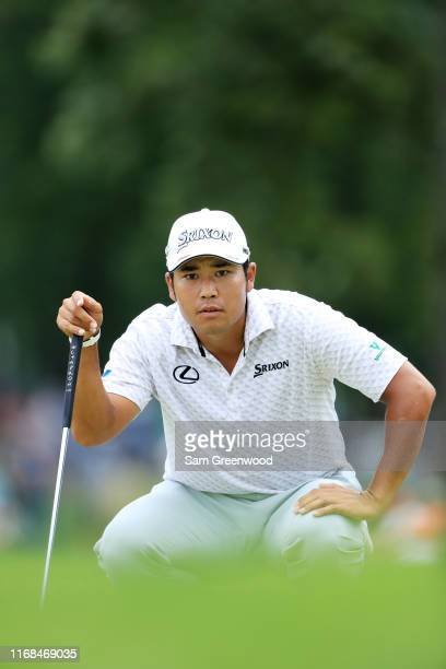 Hideki Matsuyama of Japan lines up a putt during the second round of the BMW Championship at Medinah Country Club No 3 on August 16 2019 in Medinah...