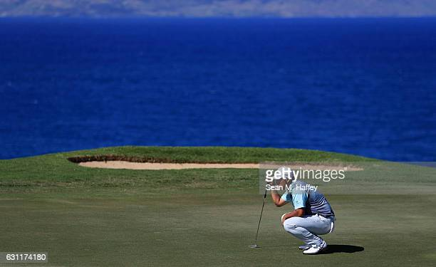Hideki Matsuyama of Japan lines up a putt on the 12th green during the third round of the SBS Tournament of Champions at the Plantation Course at...