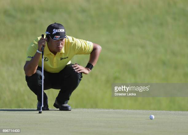 Hideki Matsuyama of Japan lines up a putt on the 13th green during the second round of the 2017 U.S. Open at Erin Hills on June 16, 2017 in Hartford,...