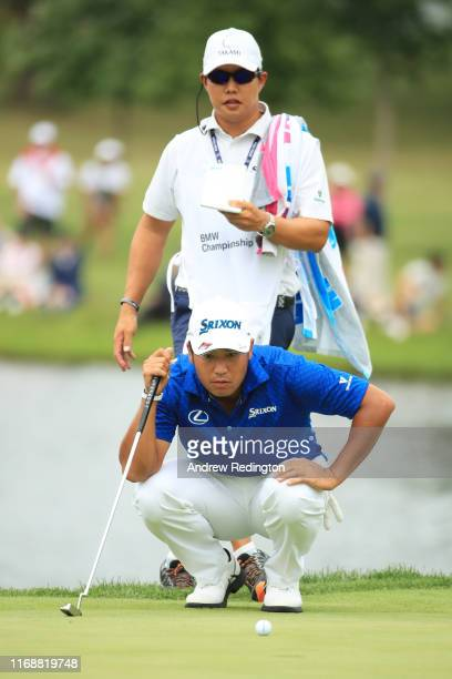 Hideki Matsuyama of Japan lines up a putt on the 15th green during the final round of the BMW Championship at Medinah Country Club No 3 on August 18...