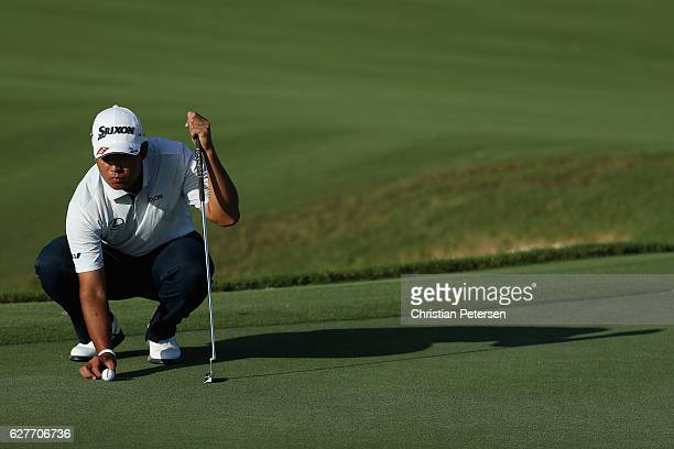 Hideki Matsuyama of Japan lines up a putt on the 16th green during the final round of the Hero World Challenge at Albany The Bahamas on December 4...
