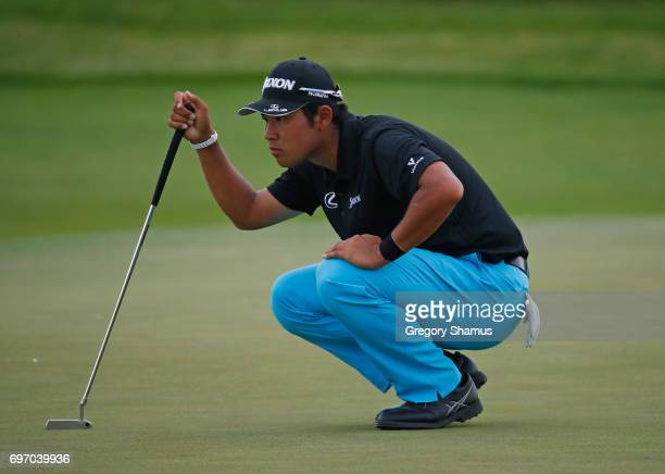 Hideki Matsuyama of Japan lines up a putt on the 17th green during the third round of the 2017 US Open at Erin Hills on June 17 2017 in Hartford...