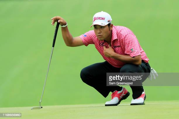 Hideki Matsuyama of Japan lines up a putt on the fourth green during the third round of the BMW Championship at Medinah Country Club No 3 on August...