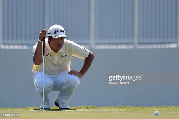 Hideki Matsuyama of Japan lines up a putt on the ninth hole during the final round of the World Golf ChampionshipsCadillac Championship at Trump...