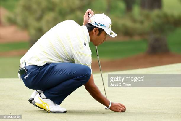 Hideki Matsuyama of Japan lines up a putt on the seventh green during the final round of the Masters at Augusta National Golf Club on April 11, 2021...