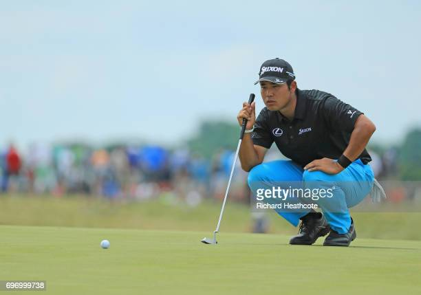Hideki Matsuyama of Japan lines up a putt on the sixth green during the third round of the 2017 US Open at Erin Hills on June 17 2017 in Hartford...