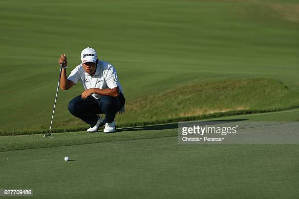 Hideki Matsuyama of Japan lines up his putt on the 17th hole during the final round of the Hero World Challenge at Albany The Bahamas on December 4...