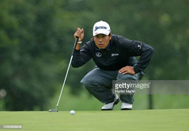 Hideki Matsuyama of Japan lines up his putt on the ninth hole during the weather delayed final round of the BMW Championship at Aronimink Golf Club...