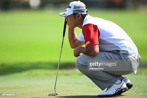 Hideki Matsuyama of Japan plays a putt on the third hole during the first round of the Sony Open In Hawaii at Waialae Country Club on January 15 2015...