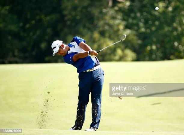 Hideki Matsuyama of Japan plays a second shot on the 14th hole during the first round of the Wyndham Championship at Sedgefield Country Club on...