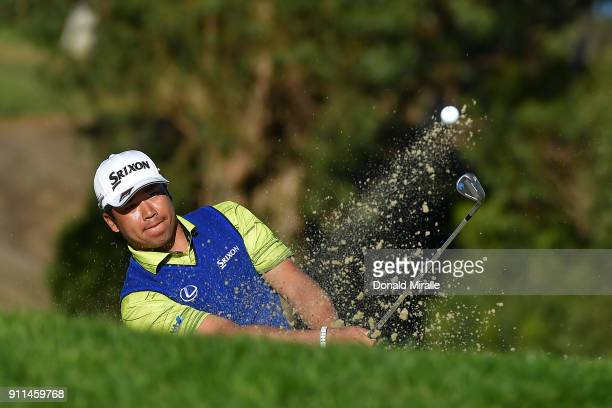 Hideki Matsuyama of Japan plays a shot from a bunker on the 13th hole during the final round of the Farmers Insurance Open at Torrey Pines South on...