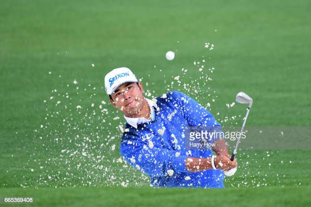 Hideki Matsuyama of Japan plays a shot from a bunker on the second hole during the first round of the 2017 Masters Tournament at Augusta National...