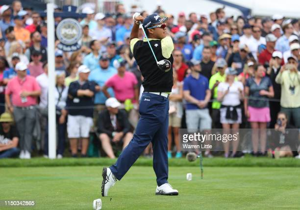 Hideki Matsuyama of Japan plays a shot from the first tee during the final round of the 2019 PGA Championship at the Bethpage Black course on May 19...
