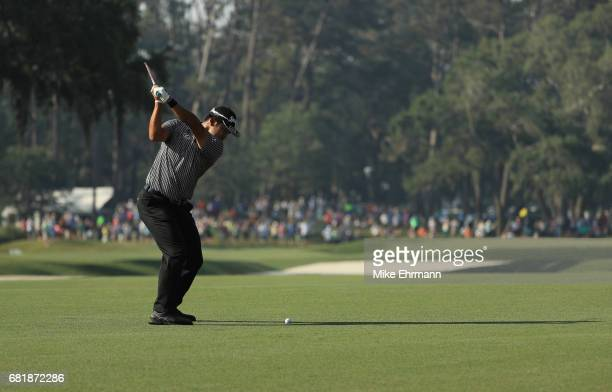 Hideki Matsuyama of Japan plays a shot on the 11th hole during the first round of THE PLAYERS Championship at the Stadium course at TPC Sawgrass on...