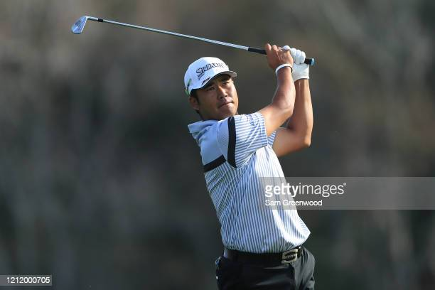 Hideki Matsuyama of Japan plays a shot on the 14th hole during the first round of The PLAYERS Championship on The Stadium Course at TPC Sawgrass on...