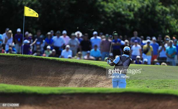 Hideki Matsuyama of Japan plays a shot on the 14th hole during the final round of the SBS Tournament of Champions at the Plantation Course at Kapalua...