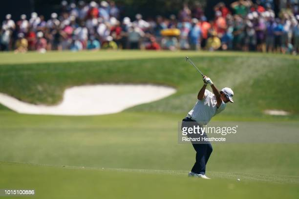 Hideki Matsuyama of Japan plays a shot on the fifth hole during the third round of the 2018 PGA Championship at Bellerive Country Club on August 11...