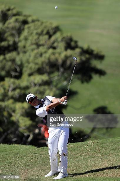 Hideki Matsuyama of Japan plays a shot on the ninth hole during the final round of the SBS Tournament of Champions at the Plantation Course at...