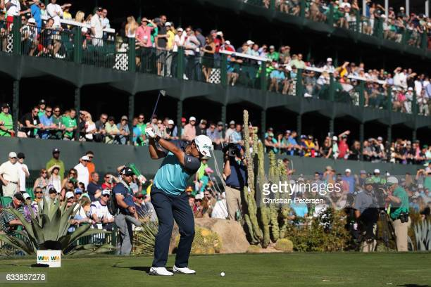 Hideki Matsuyama of Japan plays a tee shot on the 16th hole during the third round of the Waste Management Phoenix Open at TPC Scottsdale on February...
