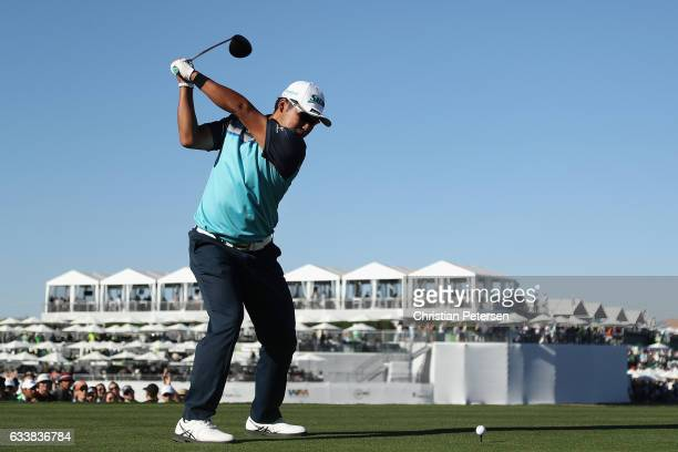 Hideki Matsuyama of Japan plays a tee shot on the 18th hole during the third round of the Waste Management Phoenix Open at TPC Scottsdale on February...