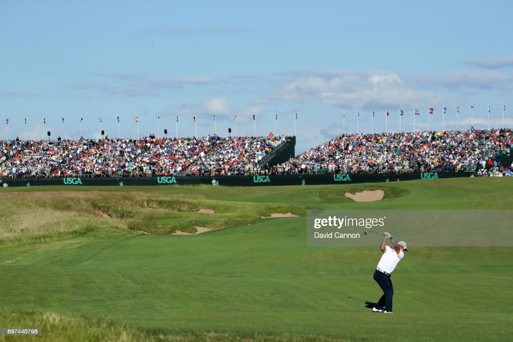 Hideki Matsuyama of Japan plays his second shot at the par 5, 18th hole during the final round of the 117th US Open Championship at Erin Hills on June 18, 2017 in Hartford, Wisconsin.