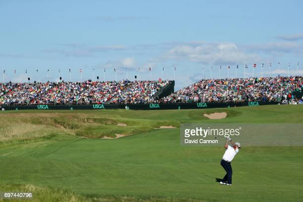 Hideki Matsuyama of Japan plays his second shot at the par 5, 18th hole during the final round of the 117th US Open Championship at Erin Hills on...