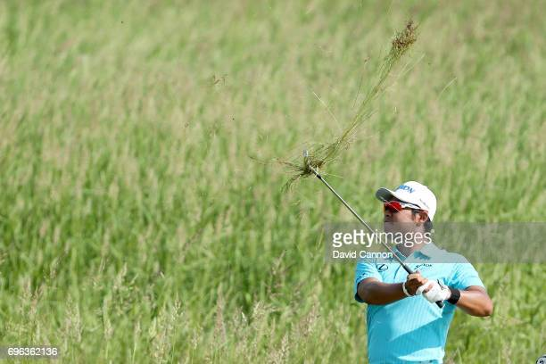 Hideki Matsuyama of Japan plays his second shot from deep rough on the par 5, 14th hole during the first round of the 117th US Open Championship at...