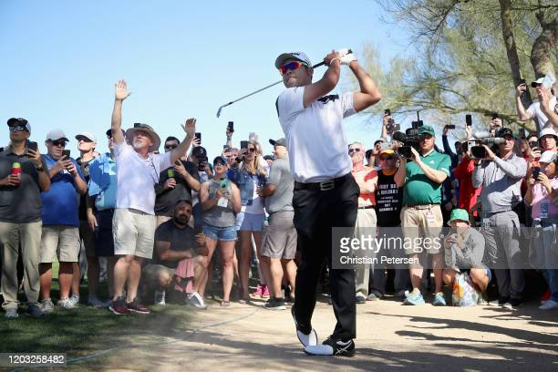 Hideki Matsuyama of Japan plays his second shot on the fifth hole during the second round of the Waste Management Open at TPC Scottsdale on January...