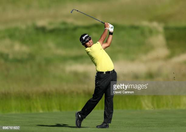 Hideki Matsuyama of Japan plays his second shot on the par 4 15th hole during the second round of the 117th US Open Championship at Erin Hills on...
