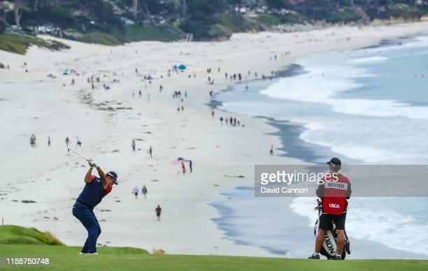Hideki Matsuyama of Japan plays his second shot on the par 4 ninth hole during the first round of the 2019 USOpen at the Pebble Beach Golf Links on...