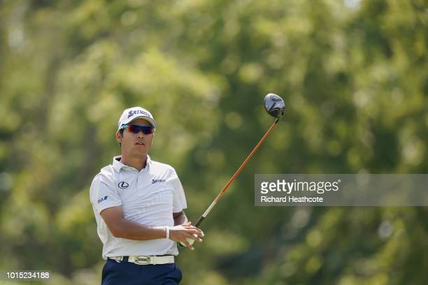 Hideki Matsuyama of Japan plays his shot from the 12th tee during the third round of the 2018 PGA Championship at Bellerive Country Club on August 11...