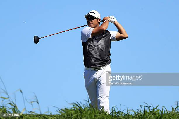 Hideki Matsuyama of Japan plays his shot from the 12th tee during the final round of the SBS Tournament of Champions at the Plantation Course at...