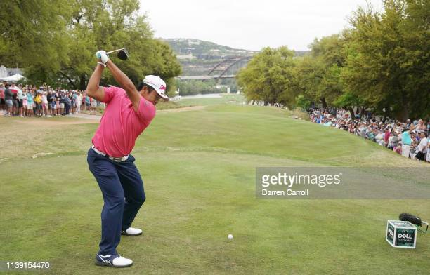 Hideki Matsuyama of Japan plays his shot from the 12th tee in his match against Dustin Johnson of the United States during the third round of the...
