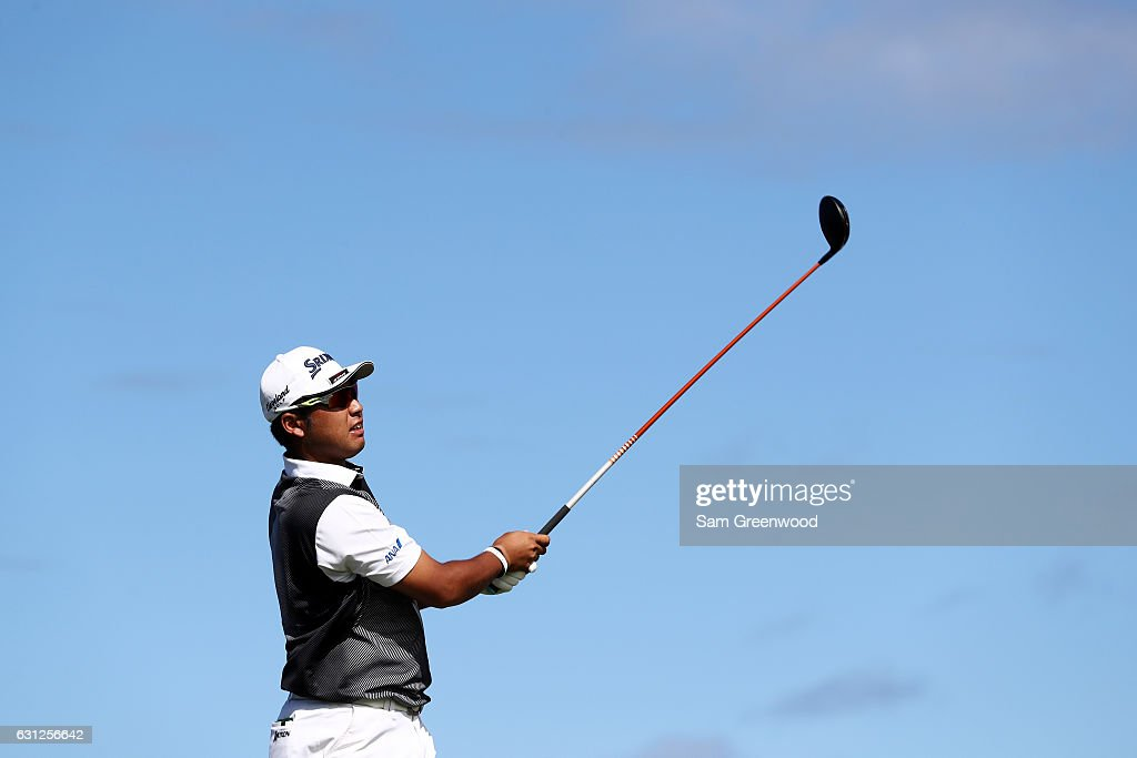 Hideki Matsuyama of Japan plays his shot from the 14th tee during the final round of the SBS Tournament of Champions at the Plantation Course at Kapalua Golf Club on January 8, 2017 in Lahaina, Hawaii.
