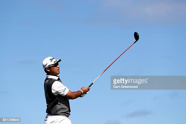Hideki Matsuyama of Japan plays his shot from the 14th tee during the final round of the SBS Tournament of Champions at the Plantation Course at...