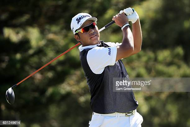 Hideki Matsuyama of Japan plays his shot from the 18th tee during the final round of the SBS Tournament of Champions at the Plantation Course at...