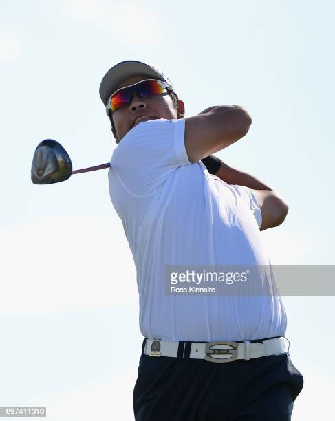Hideki Matsuyama of Japan plays his shot from the 18th tee during the final round of the 2017 US Open at Erin Hills on June 18 2017 in Hartford...