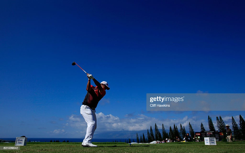 Hideki Matsuyama of Japan plays his shot from the first tee during the first round of the SBS Tournament of Champions at the Plantation Course at Kapalua Golf Club on January 5, 2017 in Lahaina, Hawaii.