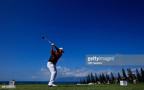 Hideki Matsuyama of Japan plays his shot from the first tee during the first round of the SBS Tournament of Champions at the Plantation Course at...