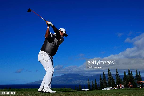 Hideki Matsuyama of Japan plays his shot from the first tee during the final round of the SBS Tournament of Champions at the Plantation Course at...