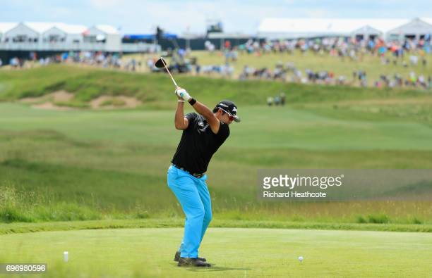 Hideki Matsuyama of Japan plays his shot from the first tee during the third round of the 2017 US Open at Erin Hills on June 17 2017 in Hartford...