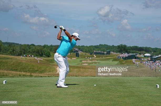 Hideki Matsuyama of Japan plays his shot from the fourth tee during the first round of the 2017 US Open at Erin Hills on June 15 2017 in Hartford...