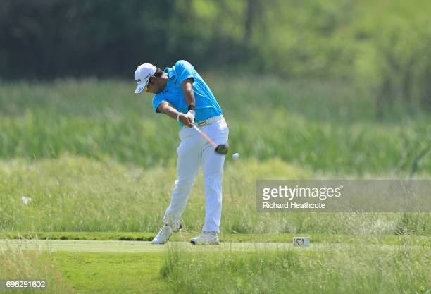 Hideki Matsuyama of Japan plays his shot from the second tee during the first round of the 2017 U.S. Open at Erin Hills on June 15, 2017 in Hartford,...