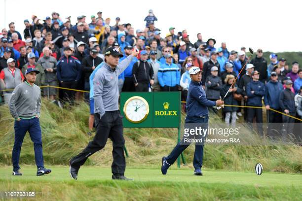 Hideki Matsuyama of Japan plays his shot from the seventh tee during the first round of the 148th Open Championship held on the Dunluce Links at...