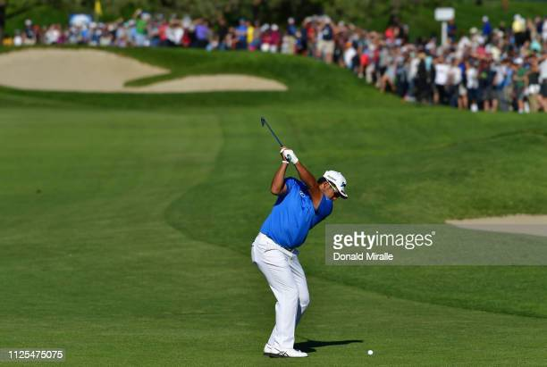 Hideki Matsuyama of Japan plays his shot on the 17th hole on the South Course during the final round of the the 2019 Farmers Insurance Open at Torrey...